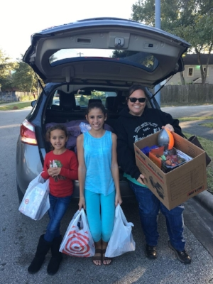 Teri, with her nieces' help, dropping off donations to DePelchin Children's Center Holiday Project.