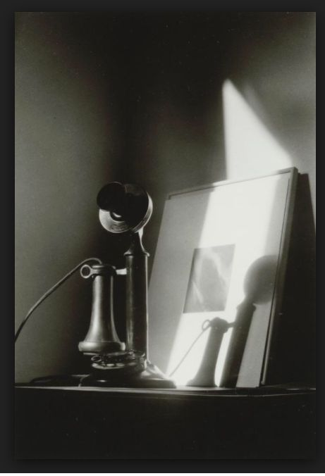 "Dorothy Norman,  Telephone, In Front of Alfred Stieglitz ""Equivalent"" at An American Place, New York , c. 1940, gelatin silver print, Gift of Howard Greenberg, 2003.053.40"