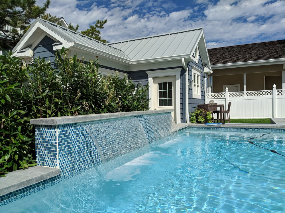 A harmonious addition in Spring Lake with a patio and pool cabana