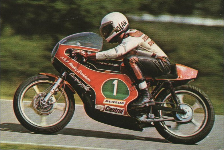 Since Villa was the only Harley-Davidson rider to carry the #1 plate in the World Championship, I assume this is he. Note the unique 'hydro-conical' front brake setup. Aermacchi-designed and manufactured H-D Sprint motors. Though totally different, they also did well in U.S. short-track racing. Neither the public nor, I suspect, Harley dealers really knew what to make of those smaller Harleys. Aermacchi was sold back to the Italians after a few years.