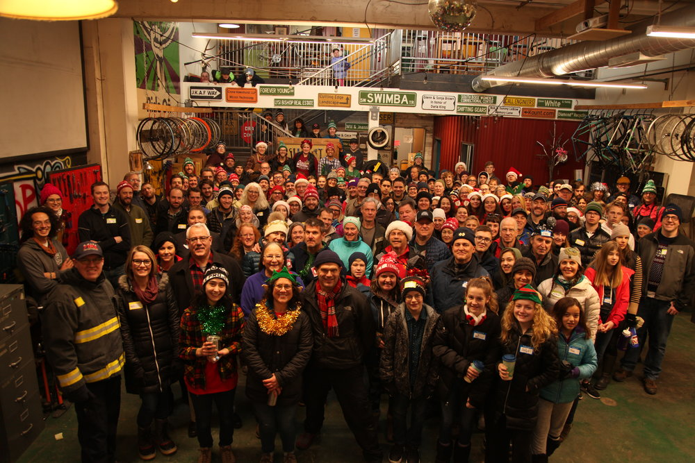 Volunteers at the record setting 2018 Holiday Kids Bike Giveaway! Photo by Mo Valko