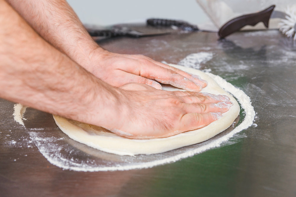 bigstock-Cook-Forms-A-Dough-Pizza-Base-173400365.jpg