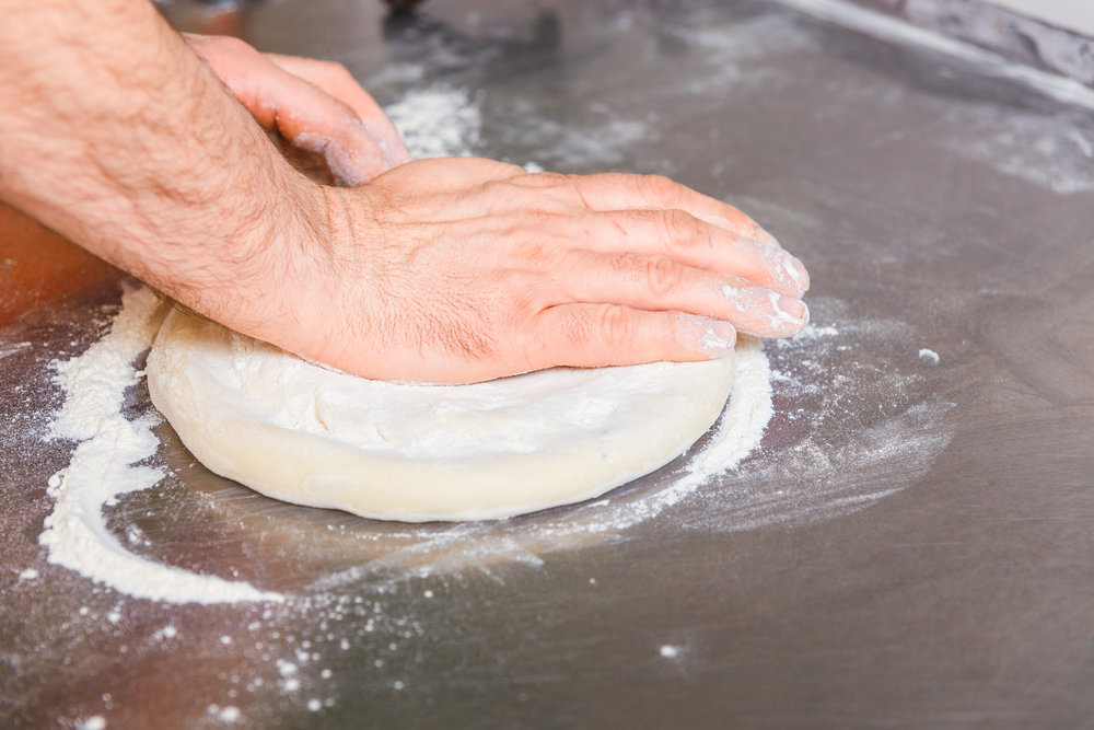 bigstock-Cook-Forms-A-Dough-Pizza-Base-173400185.jpg