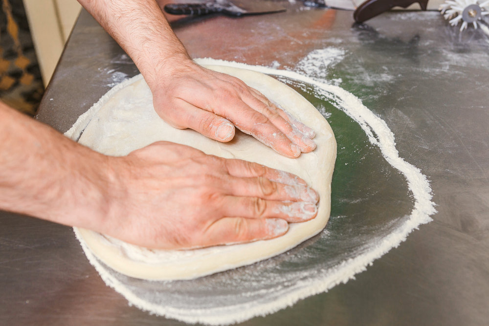 bigstock-Cook-Forms-A-Dough-Pizza-Base-173400425.jpg