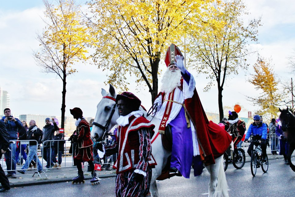 - It is quite a spectacle to watch the boats pull in, and see Sinterklaas on his giant white horse, followed by his massive entourage embark on their huge welcome parade. Candy is everywhere. It is handed out by participants, tossed by the sackload from floats and even blown out of giant cannons. The parade winds through the city streets, heralding in the holiday season. His sidekicks, Zwarte Pieten, keep a record of all the things naughty children have done and they could end up being put in a sack to be sent back to Spain to learn how to behave. Or to serve Sinterklaas. It is not entirely clear. So beware if you think you may be on a naughty list.