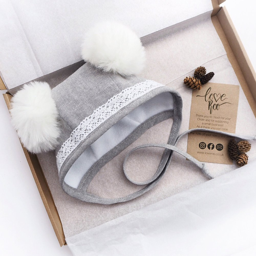 Lace Pom Pom Winter Bonnet   : £24.99  Grey linen with lace and handmade white faux fur pom poms.   - Love Roo