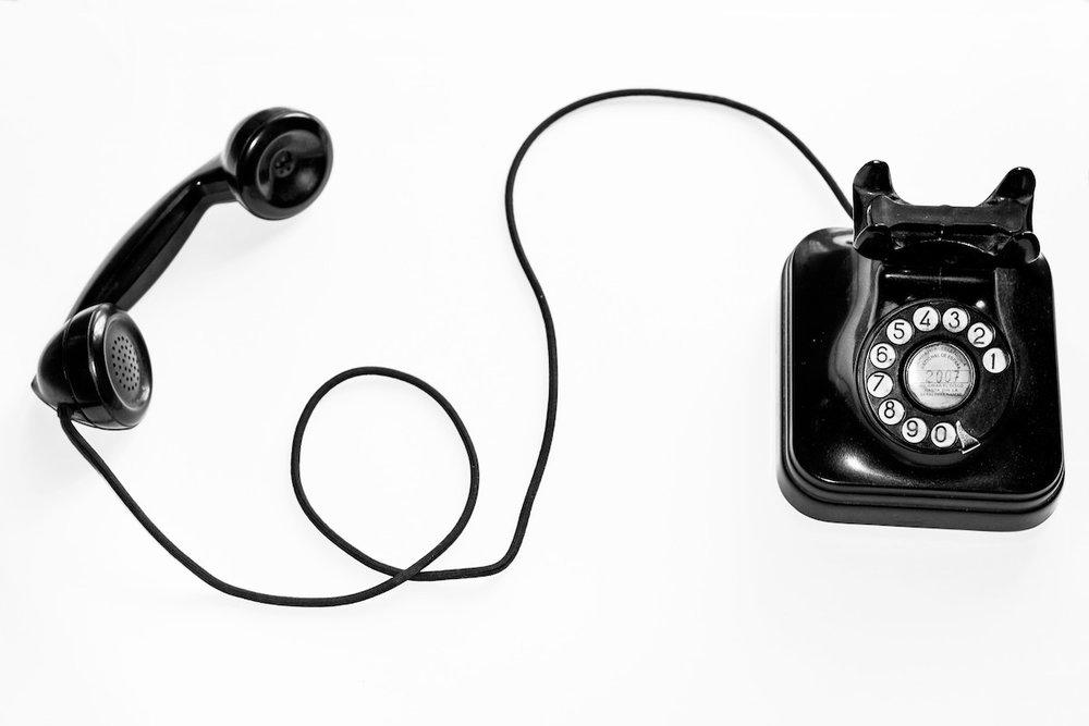 Retro black rotary phone and handset.