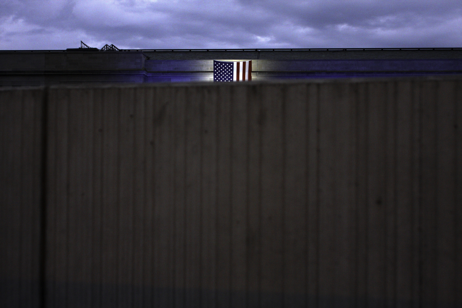 An American flag hangs off the side of the Pentagon at the opening of the Pentagon 9/11 Memorial in 2008.