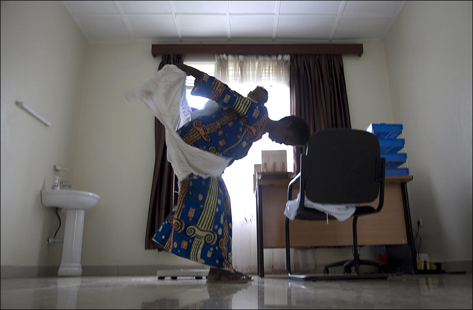 A mother wraps her child onto her back after meeting with a nurse in Kigali, Rwanda.