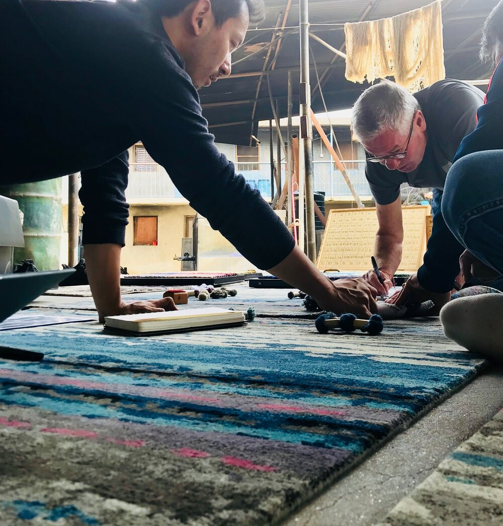 Jim and Dortje selecting colors in our factory in Kathmandu