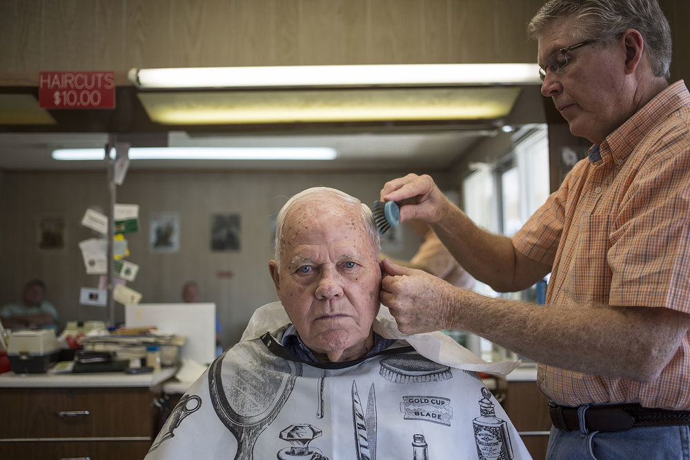 My pap-paw Pete Armes, 91, gets a haircut from lifetime Franklin, North Carolina resident Ronnie Dills. Dills has been cutting hair for 45 years, 43 in this location and generations of residents have pulled up a seat for a trim.