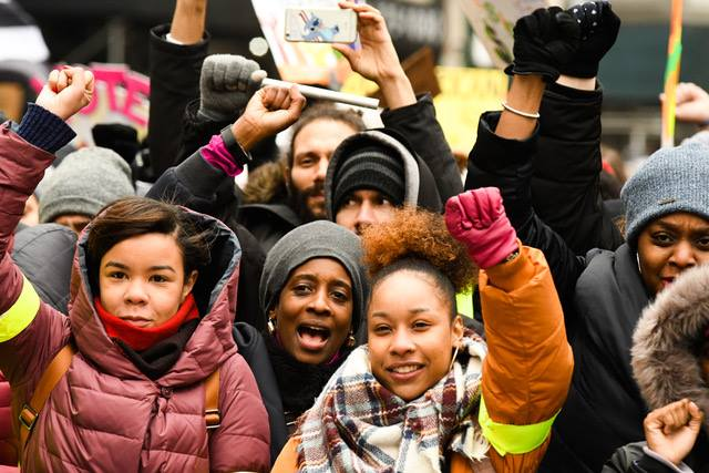 Cidra Sebastien and youth of Harlem based organization Brotherhood Sister-Sol cheering at the Jan 19, 2019 Women's Unity Rally at Foley Square.