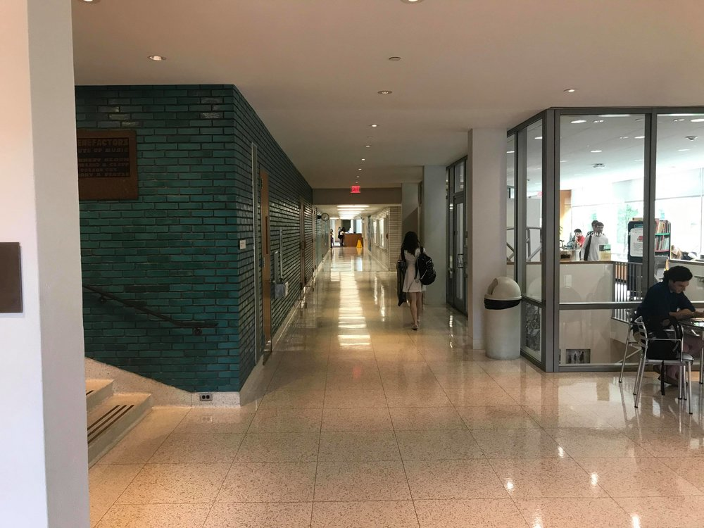 One of the main hallways for CIM; to the right is the library, along with computers, printers, and other resources. The left is Kulas performance hall, where the majority of CIM's concerts, opera productions, and mass recitals take place.