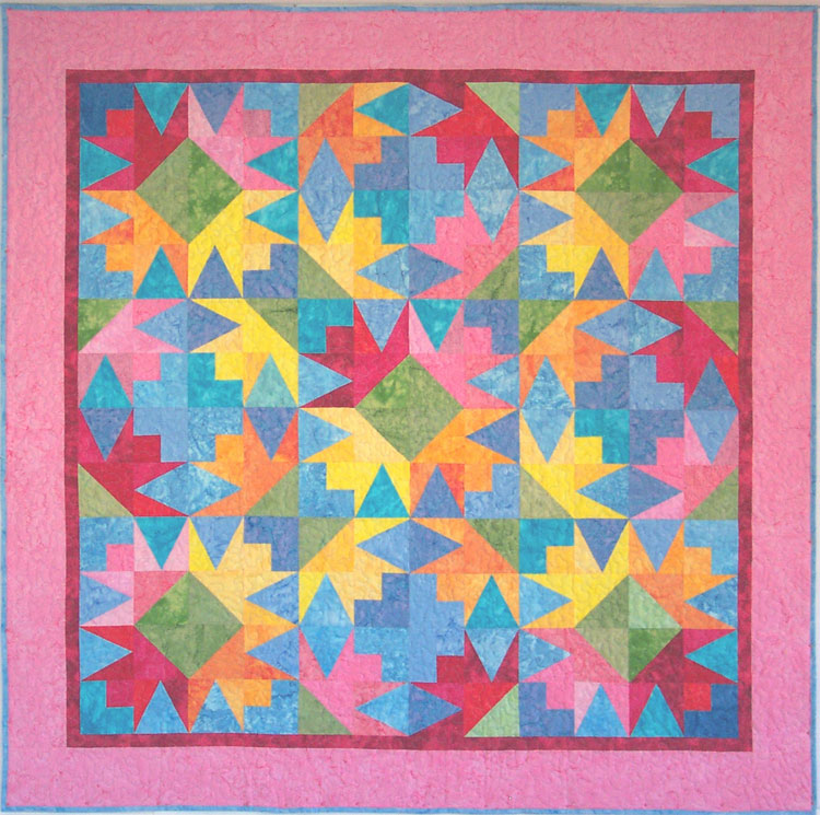 custom colorful batik quilt by Whimzie Quiltz and More