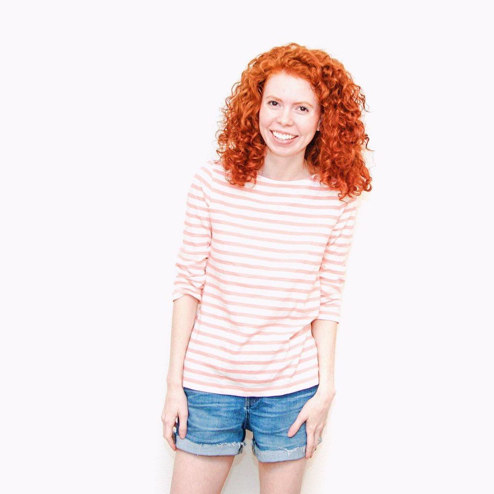 girl-in-pink-stripes-and-jean-shorts