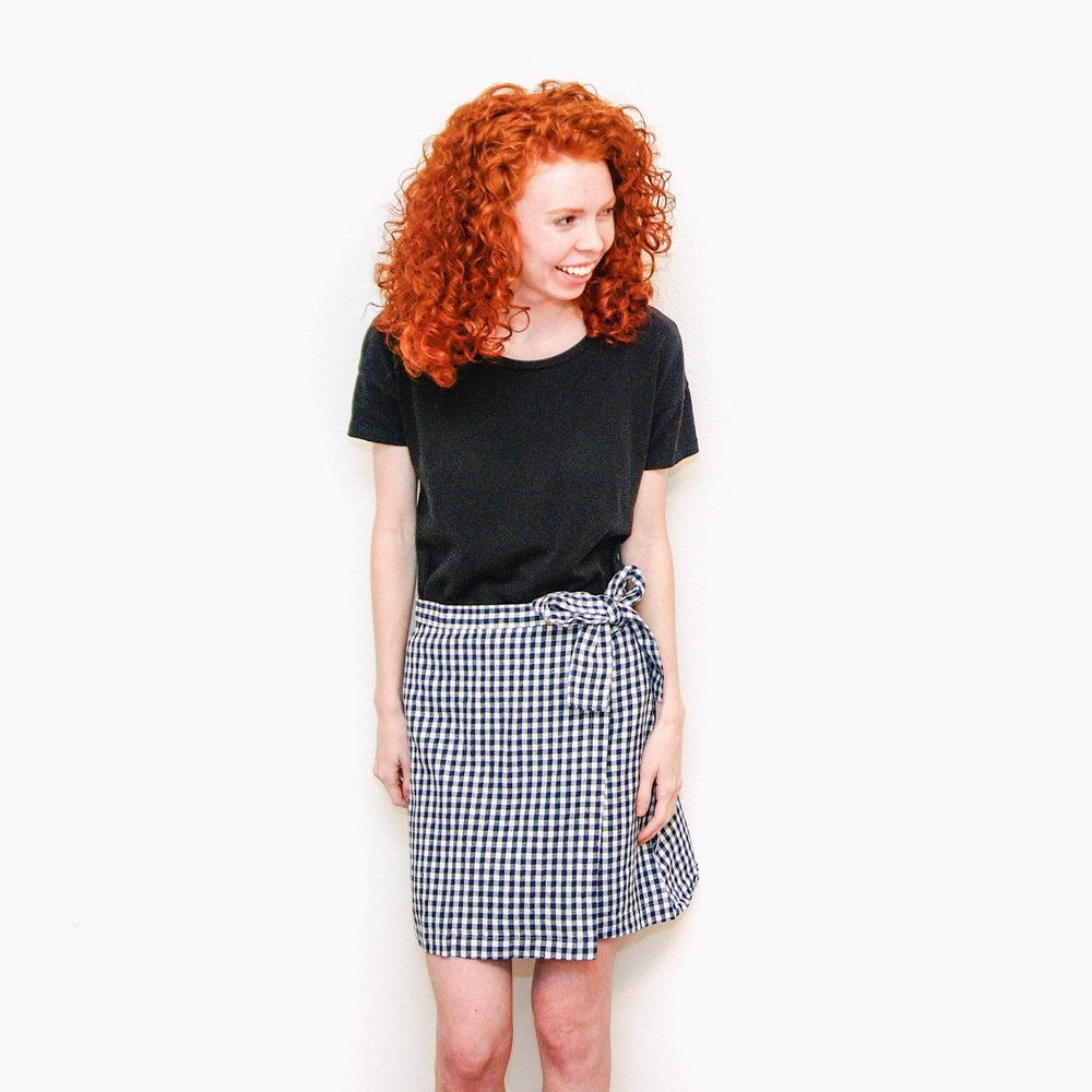 girl-in-black-shirt-and-gingham-skirt