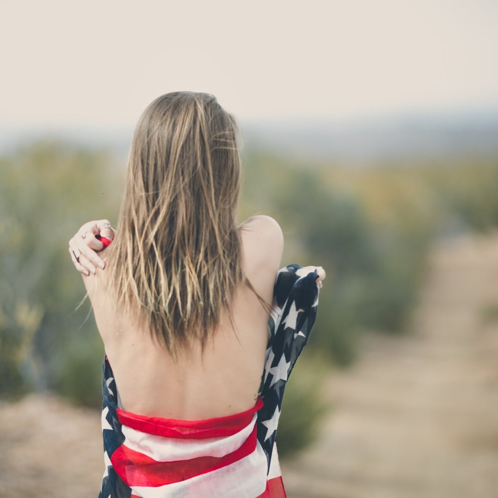woman-wrapped-in-usa-flag