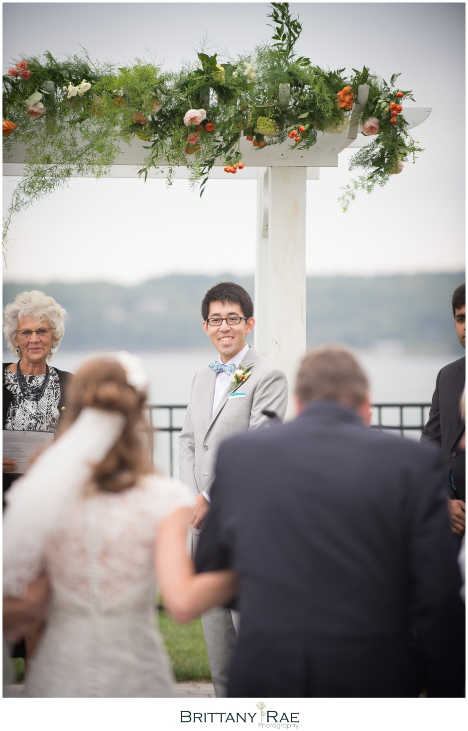Groom seeing the bride walk down the aisle by Samoset Resort Wedding Photographer, Brittany Rae Photography
