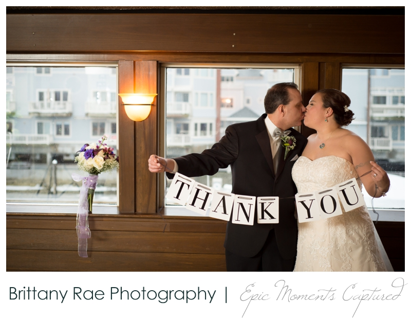 Dimillo's Floating Restaurant wedding photos - thank you sign wedding portrait