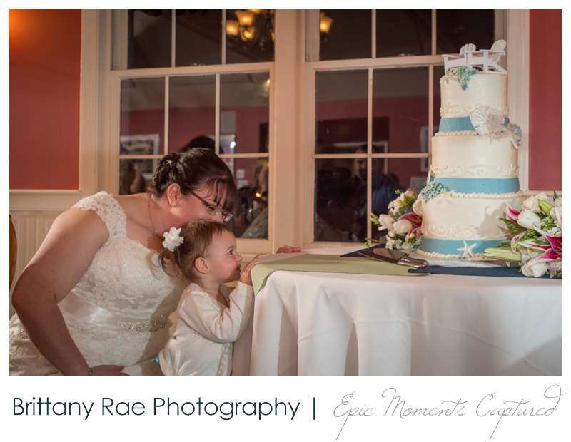 Kennebunkport Wedding | Pemaquid Light Wedding - flower girl looking at the cake