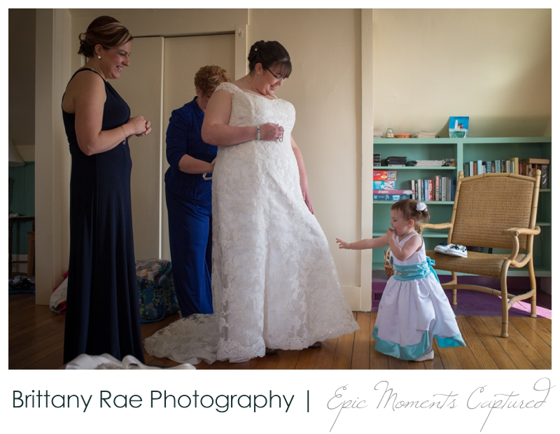 Kennebunkport Wedding | Pemaquid Light Wedding - flower girl playing with brides dress