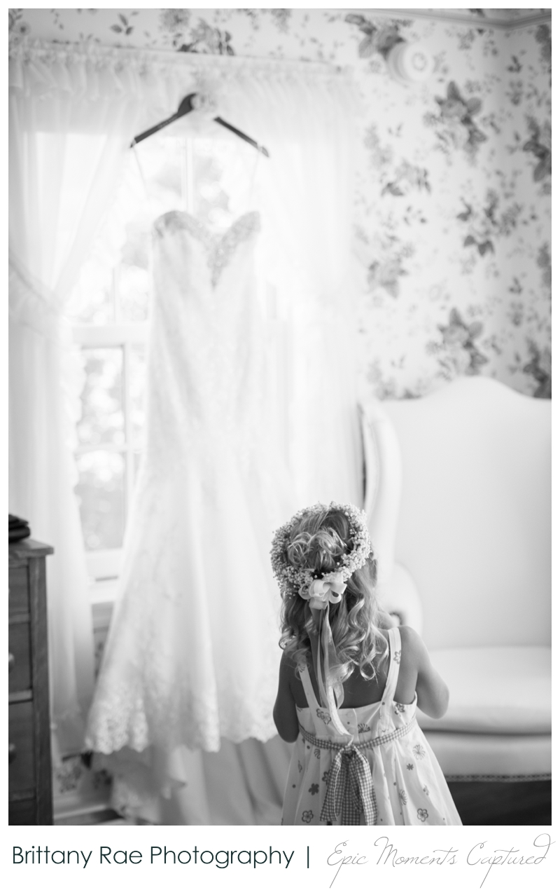 The Colony Hotel Wedding in Kennebunkport Maine - flower girl with brides gown