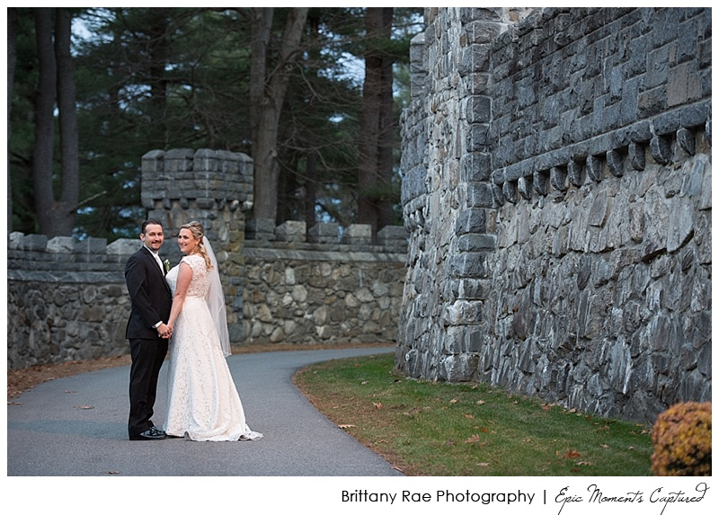 Searles Castle Wedding in Windham NH - Couple along castle walls