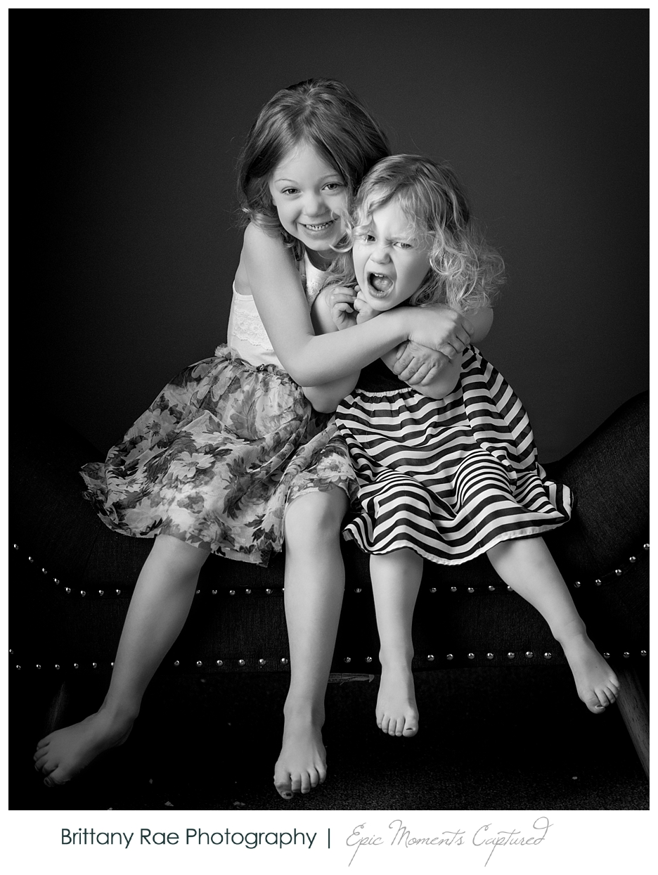 Black and White Children's Portraits in Scarborough Maine - Sisters being funny