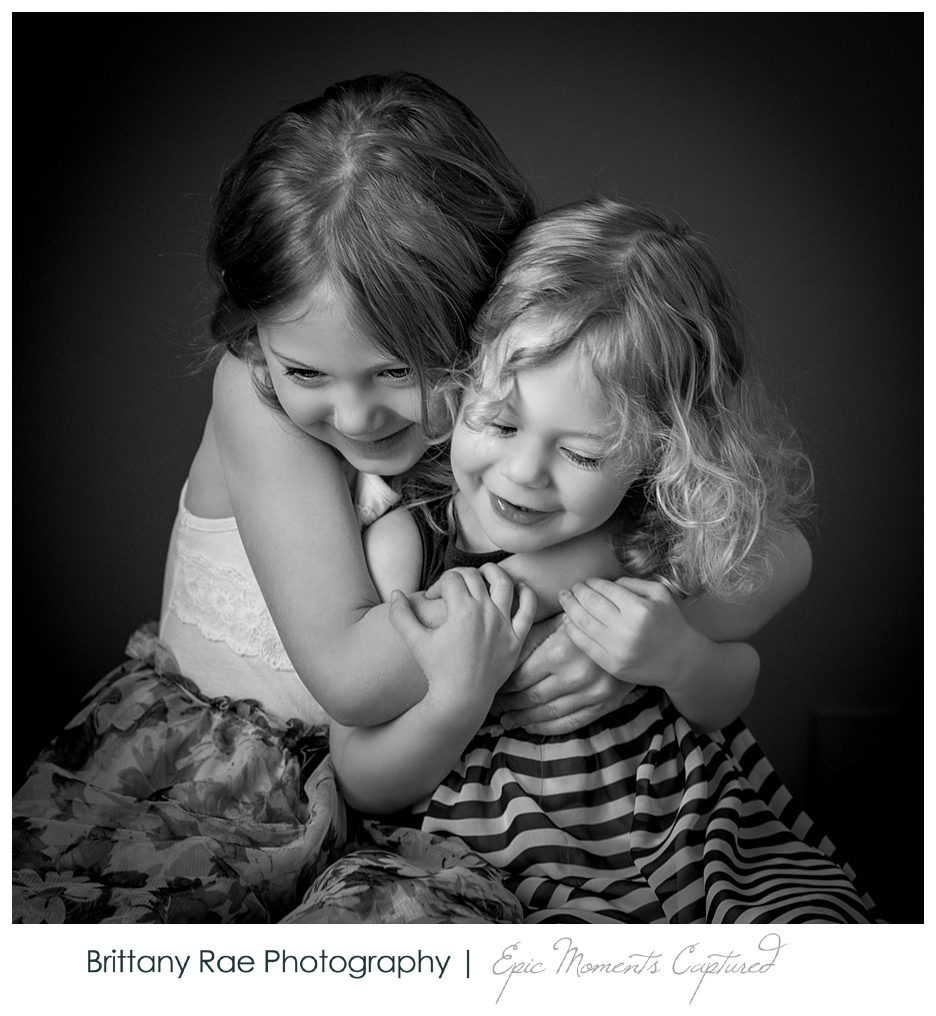 Black and White Children's Portraits in Scarborough Maine - Sisters hugging