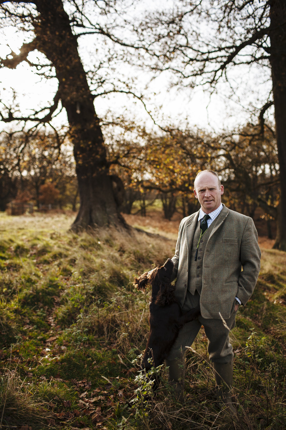 Gamekeeper David Wiggins poses for a photograph with one of his dogs in Berkshire, England, Friday, Nov. 21, 2008. (David Azia for The New York Times)