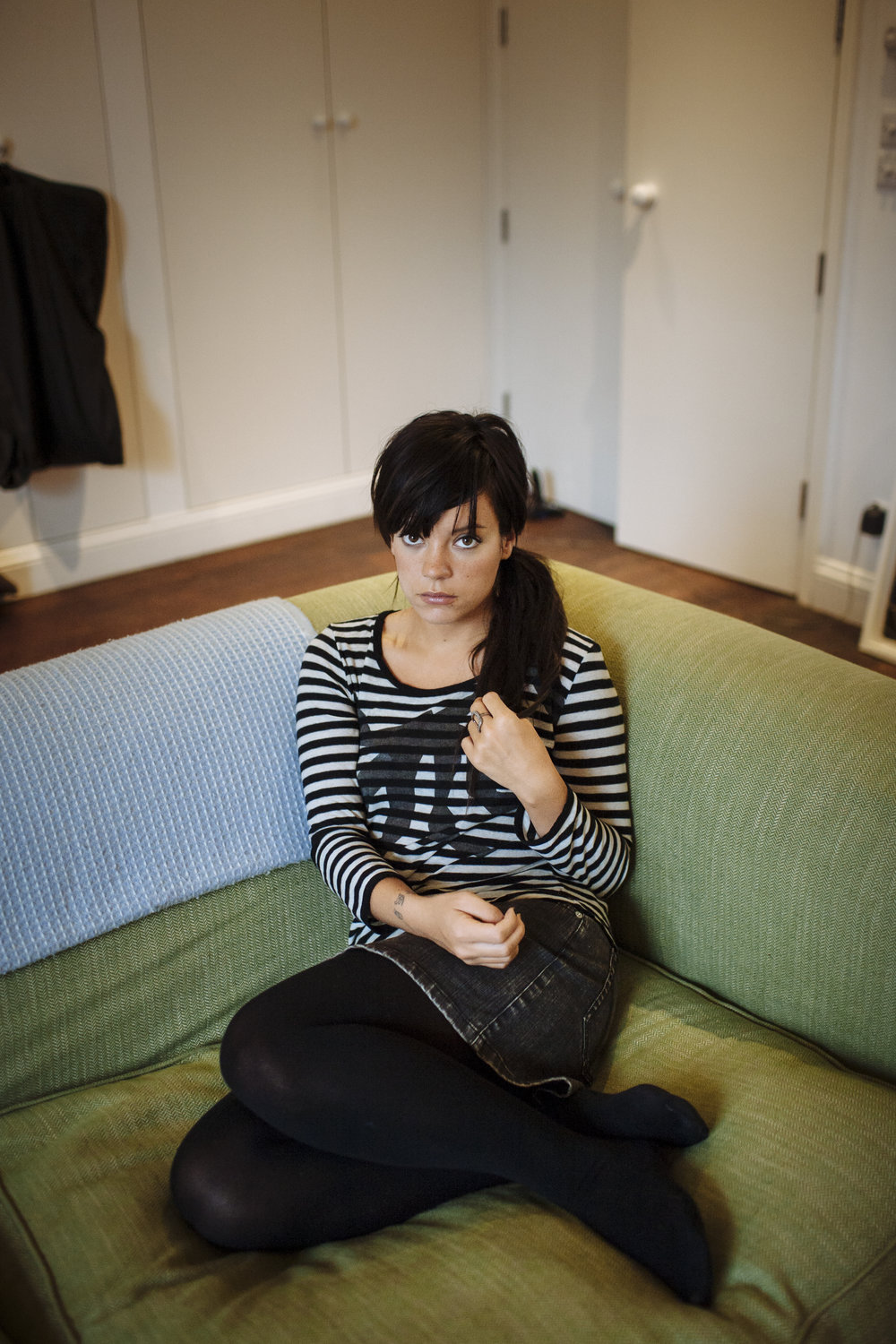 British singer Lily Allen poses for a photograph in her living room at her home in Kilburn, northwest London, Tuesday, Jan. 13, 2009. (David Azia for The New York Times)