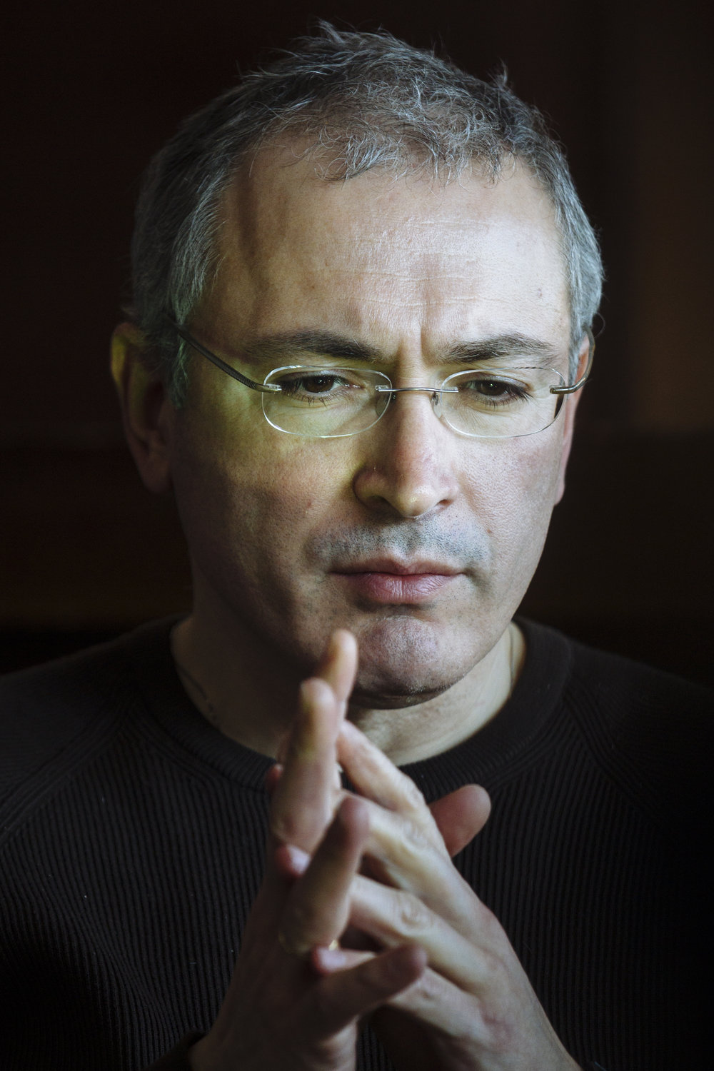 Exiled Russian businessman Mikhail Khodorkovsky listens to a question during a roundtable with journalists at a hotel in Kiev, Ukraine, Monday, March 10, 2014. (AP Photo/David Azia)