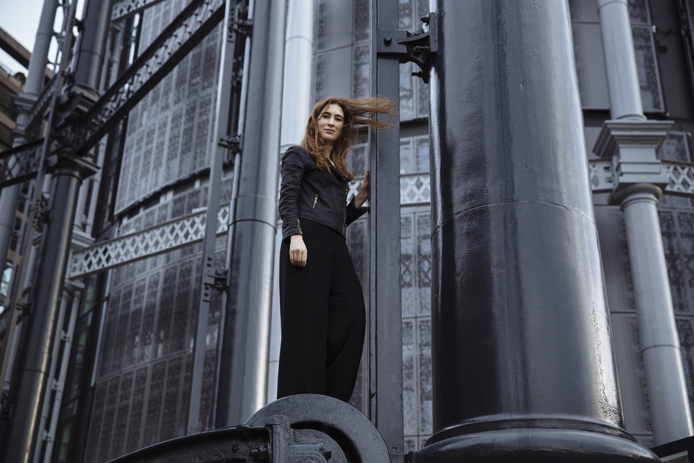 British author Katherine Rundell stands atop the guide frame of a renovated gasometer, Gasholder Park, near King's Cross, London, England, Wednesday, Dec. 7, 2016. (David Azia for Newsweek)