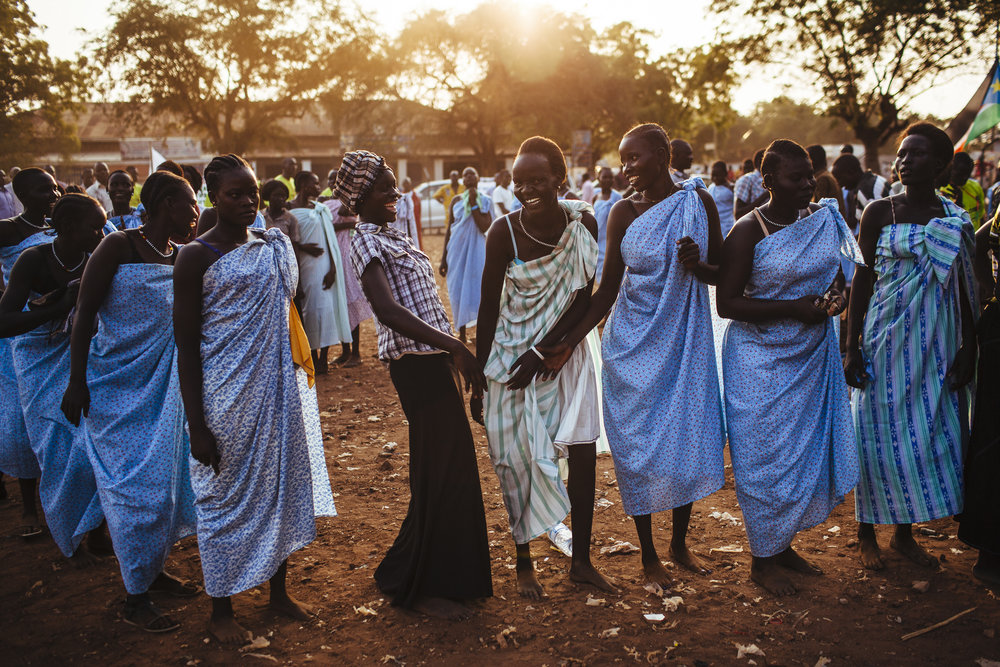 Women from the Bari community laugh after performing a traditional dance during celebrations on the eve of South Sudan's declaration of independence in Juba, southern Sudan, Friday, July 8, 2011. (AP Photo/David Azia)