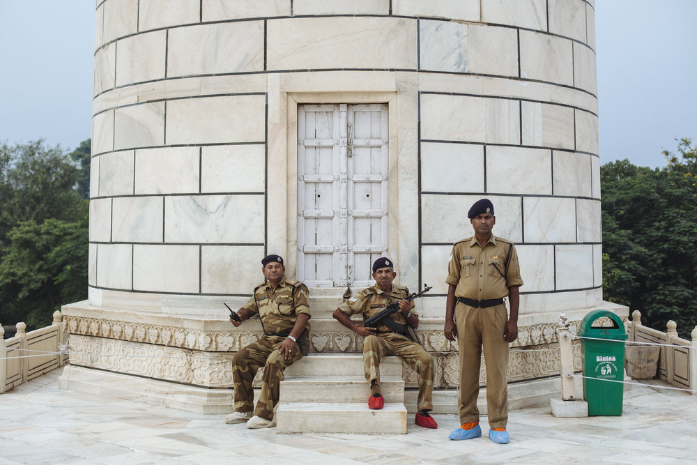 India's Central Industrial Security Force soldiers wearing protective shoe covers, guard outside the Taj Mahal mausoleum in Agra, India, Monday, Oct. 18, 2010. Shoes are not allowed in the Taj Mahal, as they wear down the marble.