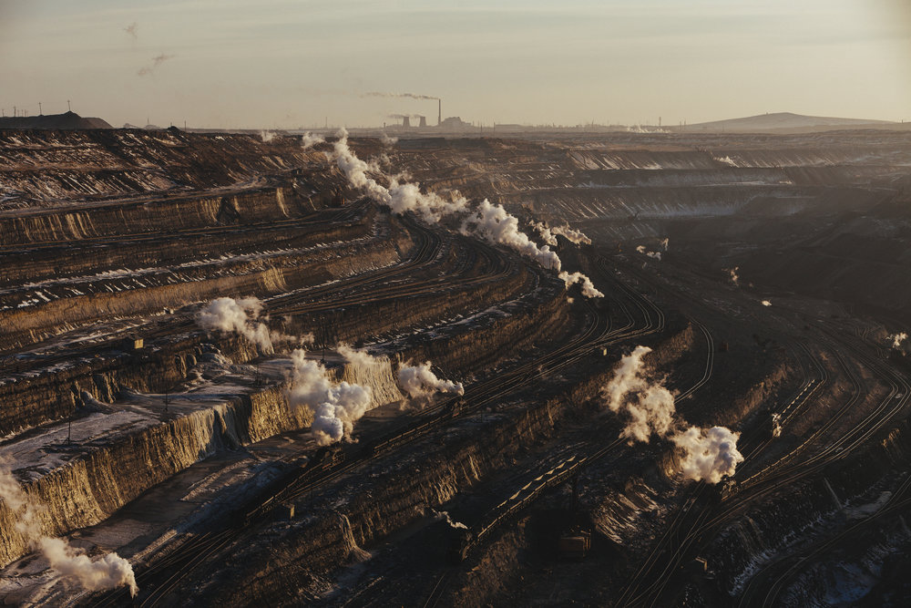 Steam locomotives operate in an open cast coal mine in Zhalainuer, Inner Mongolia, China, Tuesday, March 24, 2009.