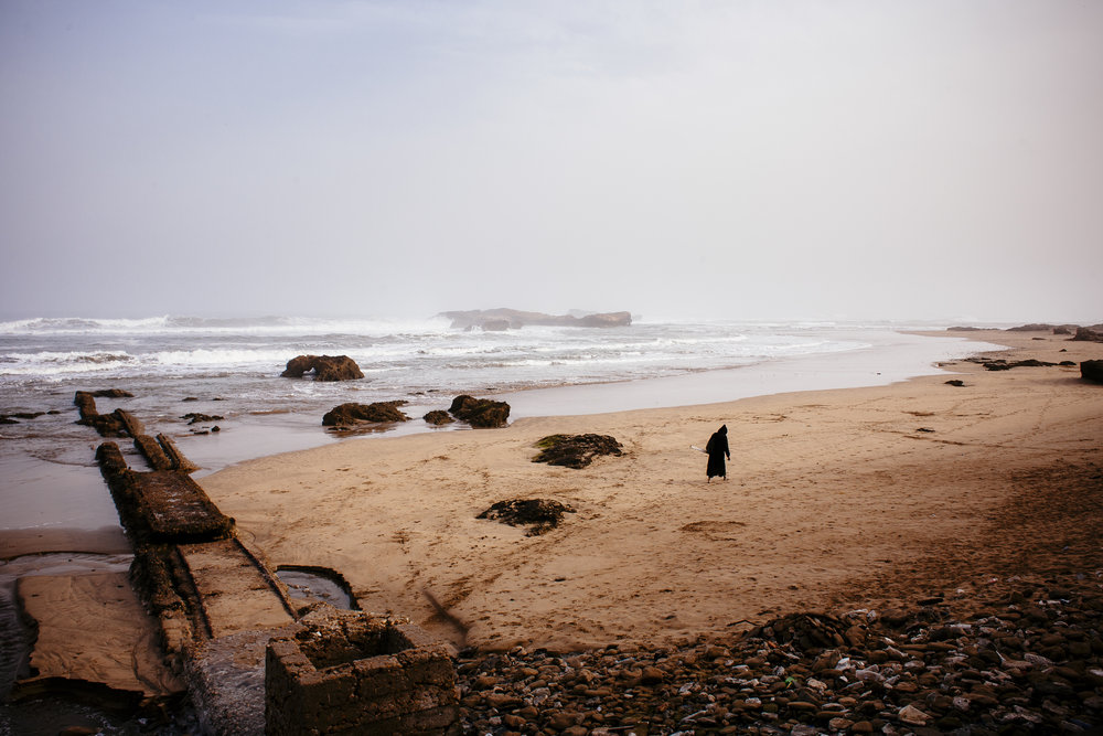 A man walks along a beach in Essaouira, Morocco, Wednesday, March 14, 2007.