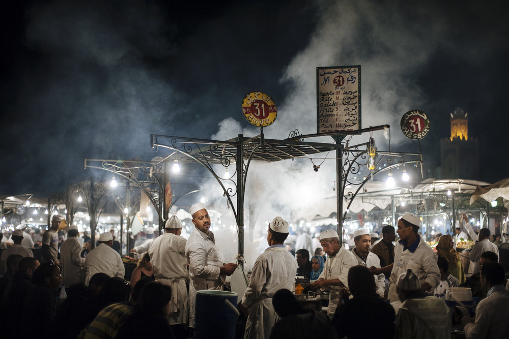 People gather around a food stall in Jemaa el Fna, Marrakesh, Morocco, Monday, March 12, 2007.