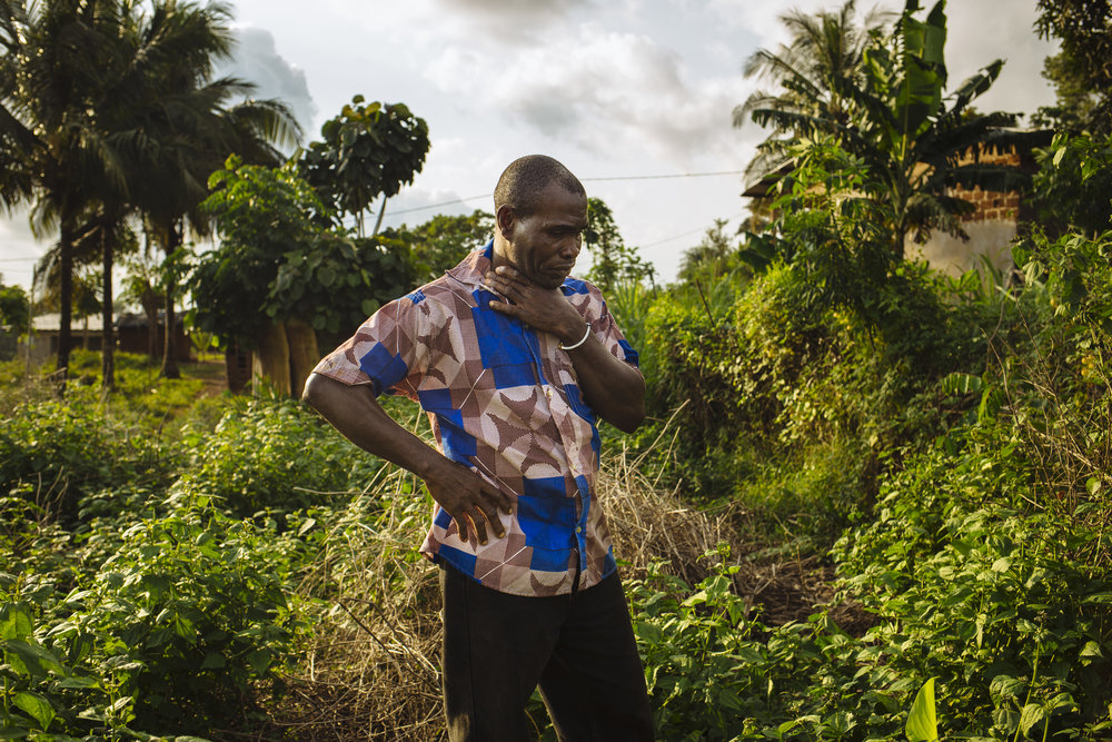 Gbohoun Hie breaks down in tears as he stands on the site where his home once stood in Tabou, Bas-Sassandra District, Côte d'Ivoire.