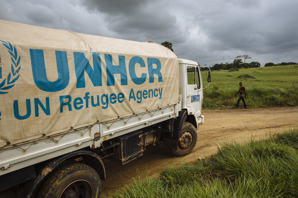 A UNHCR truck, forming part of a convoy repatriating Ivorian refugees to Côte d'Ivoire, departs from Little Wlebo refugee camp, approximately 15 kilometres (9 miles) from Harper, Maryland, Liberia.