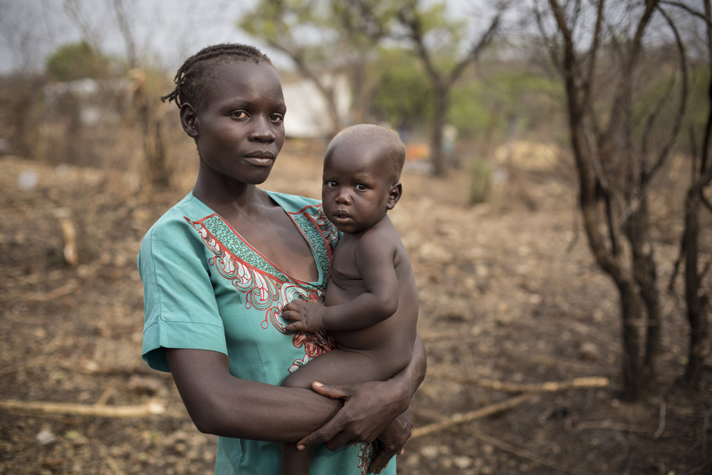 South Sudanese refugee Kiden Sam, 28, holds her nine-month-old son Isaac Kiri in Bidibidi refugee settlement, Yumbe District, Northern Region, Uganda.