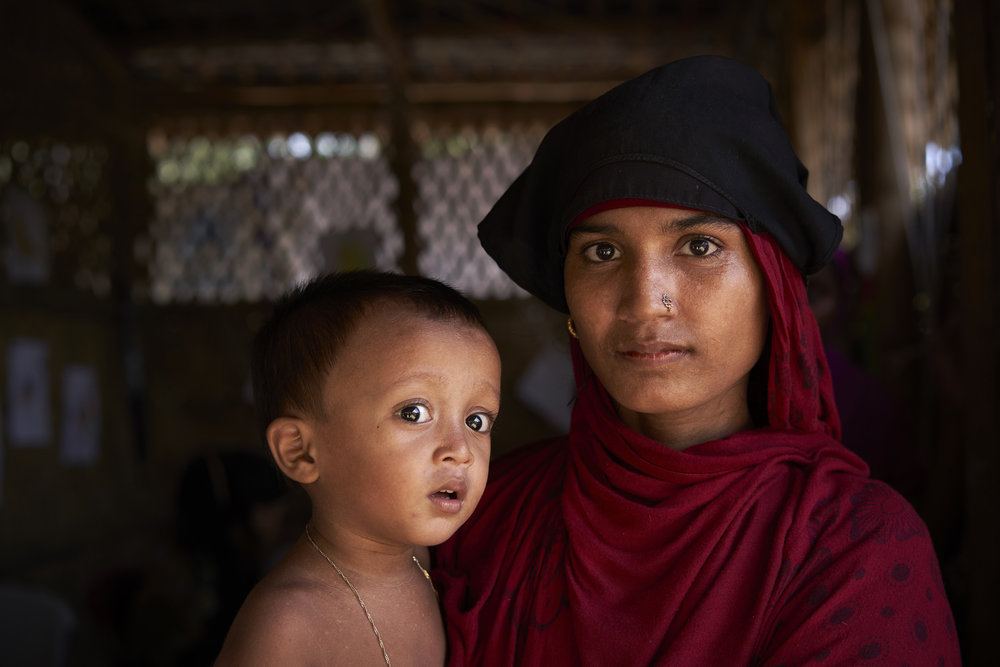 Rohingya refugee Shatara Begum, 18, holds her 14-month-old daughter Shatara, as she poses for a photograph at the UNHCR counselling center in the UNHCR transit center, in Kutupalong, Ukhia, Cox's Bazar District, Bangladesh.