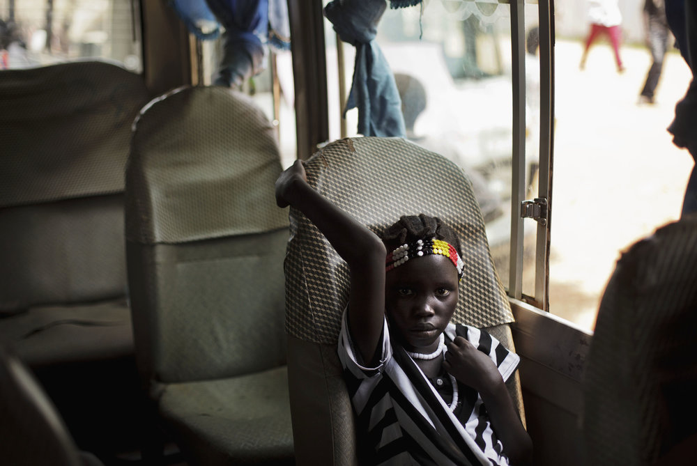 A youth sits in a bus following rehearsals for independence celebrations in Juba, southern Sudan, Tuesday, July 5, 2011. South Sudan is set to declare independence from the north on Saturday, July 9. (AP Photo/David Azia)
