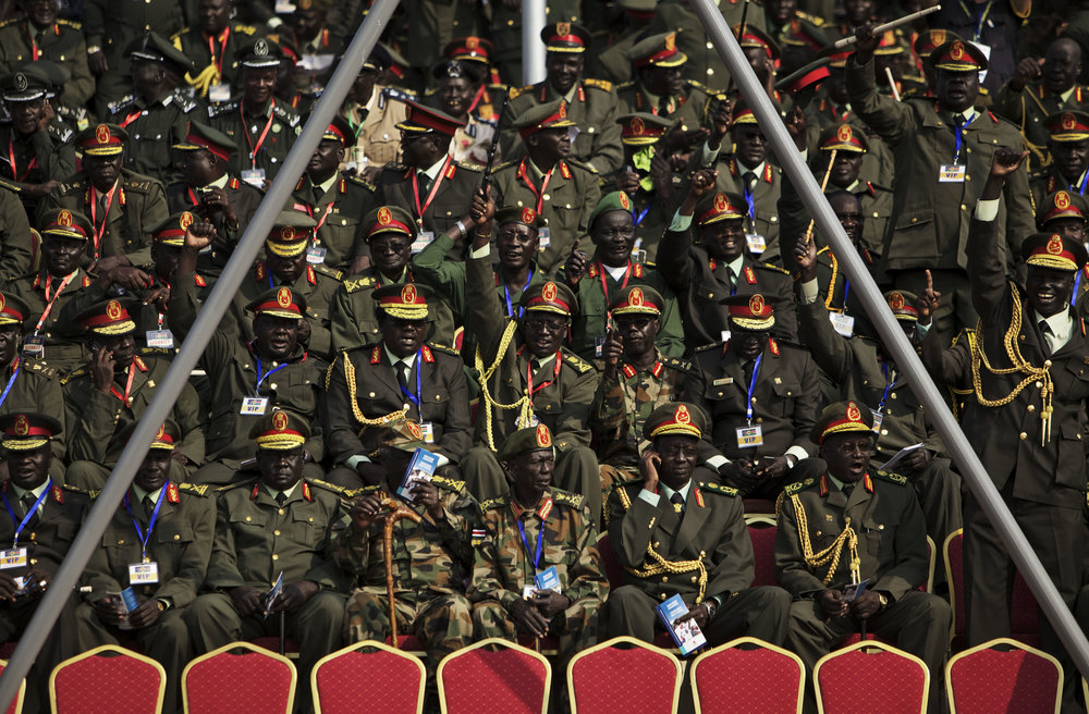 Sudan People's Liberation Army generals wait for the start of independence celebrations in Juba, South Sudan, Saturday, July 9, 2011. (AP Photo/David Azia)