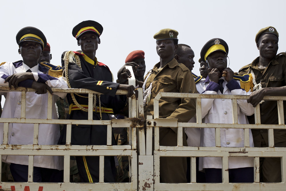 Police officers and members of a band are seen aboard a truck ahead of a rehearsal for independence celebrations in Juba, southern Sudan, Thursday, July 7, 2011. South Sudan is set to declare independence from the north on Saturday, July 9th. (AP Photo/David Azia)