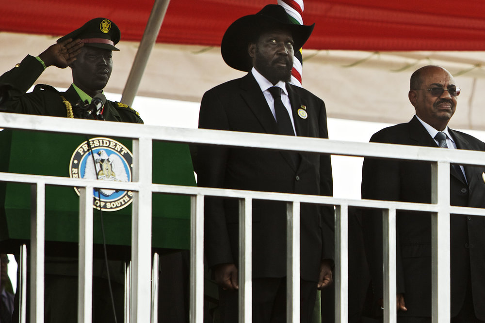 South Sudan's president Salva Kiirr, left, and Sudan's President Omar al-Bashir stand on the podium at the start of independence celebrations in Juba, South Sudan, Saturday, July 9, 2011. (AP Photo/David Azia)