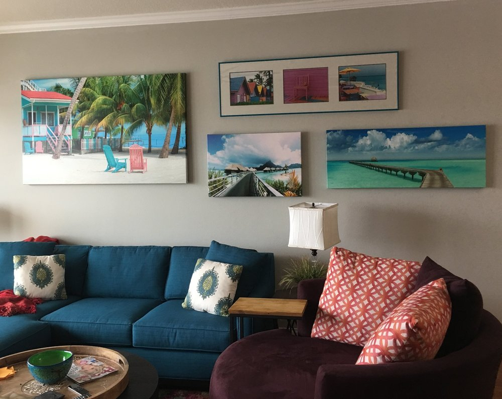 colorful living room accessorizing art work custom pillows