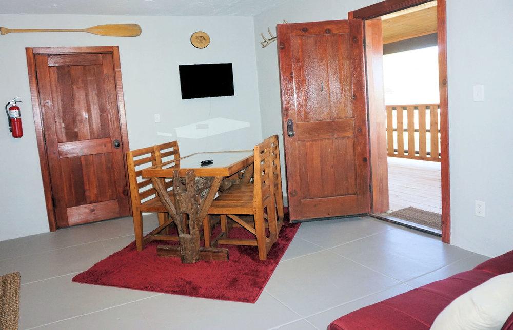 Bunk house 1 kitchen table to front door.jpg