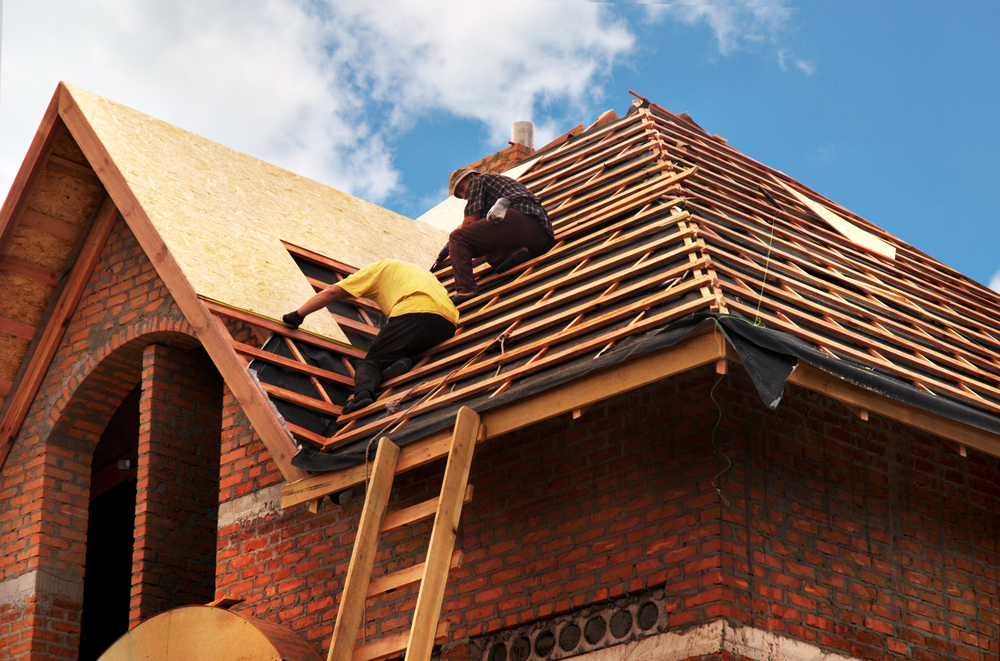 Workers making new roof