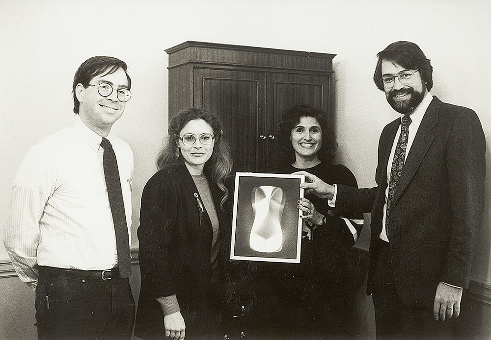 Commemorative photo of the first digital PHSCologram,  Etruscan Venus , NCSA. Left to right: Tom DeFanti, Donna Cox, Ellen Sandor, and Larry Smarr, circa 1986. Courtesy of Ellen Sandor, (art)n.